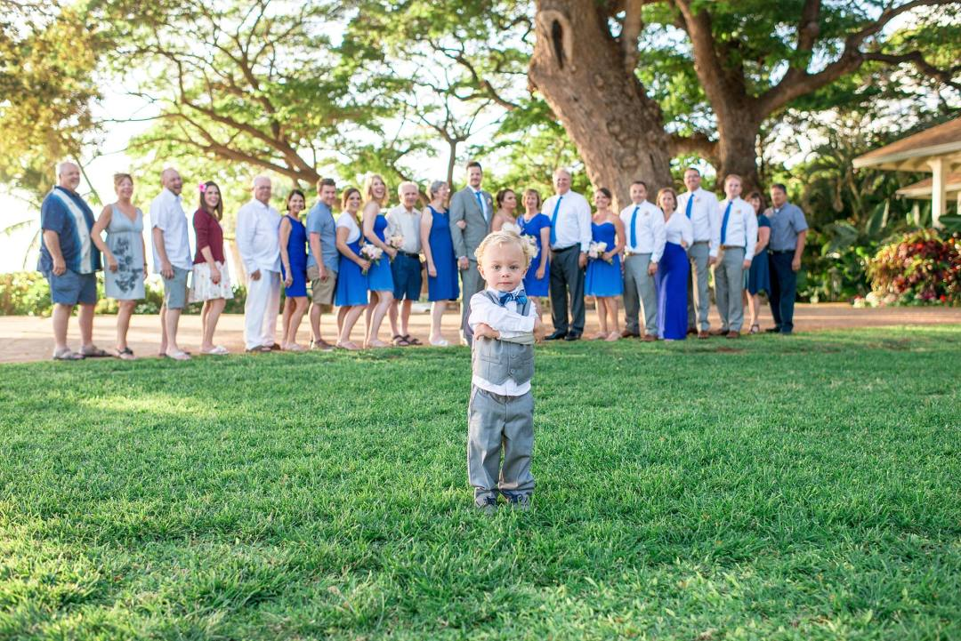 group wedding shot with tough guy ring bearer in the foreshot