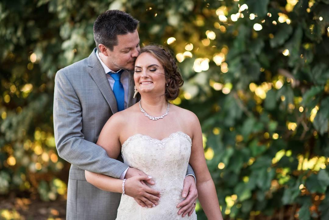 newly married couple husband kissing forhead