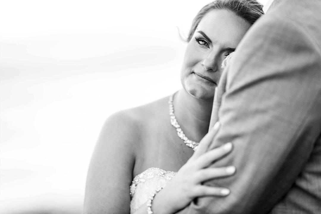 bride hugging her husband