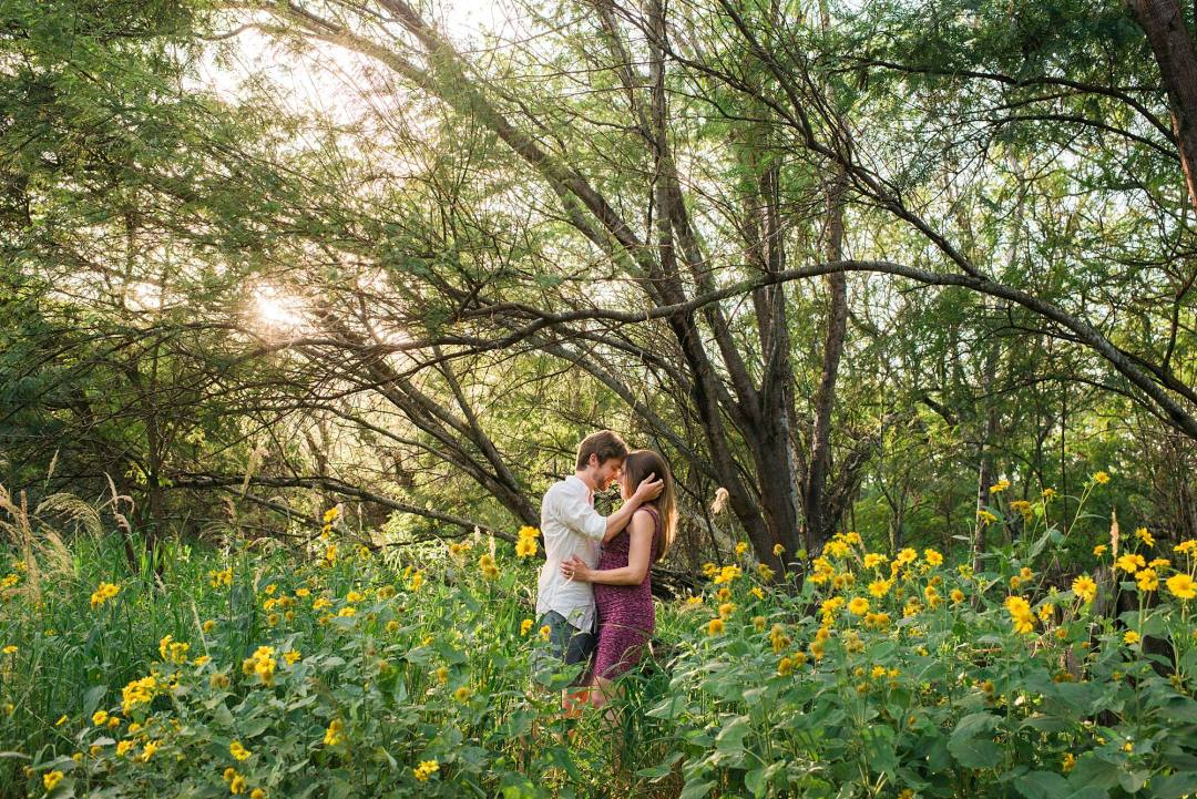 man and wife sharing a romantic moment in the flower field of Maui