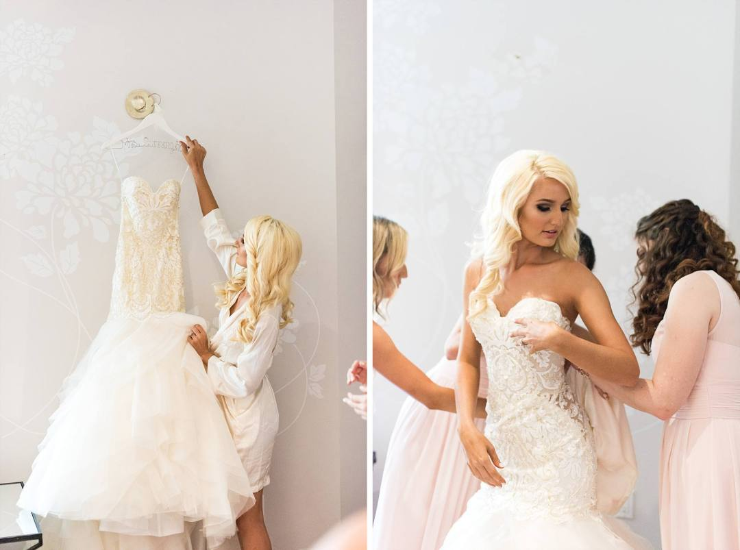 gorgeous bride getting her gown on