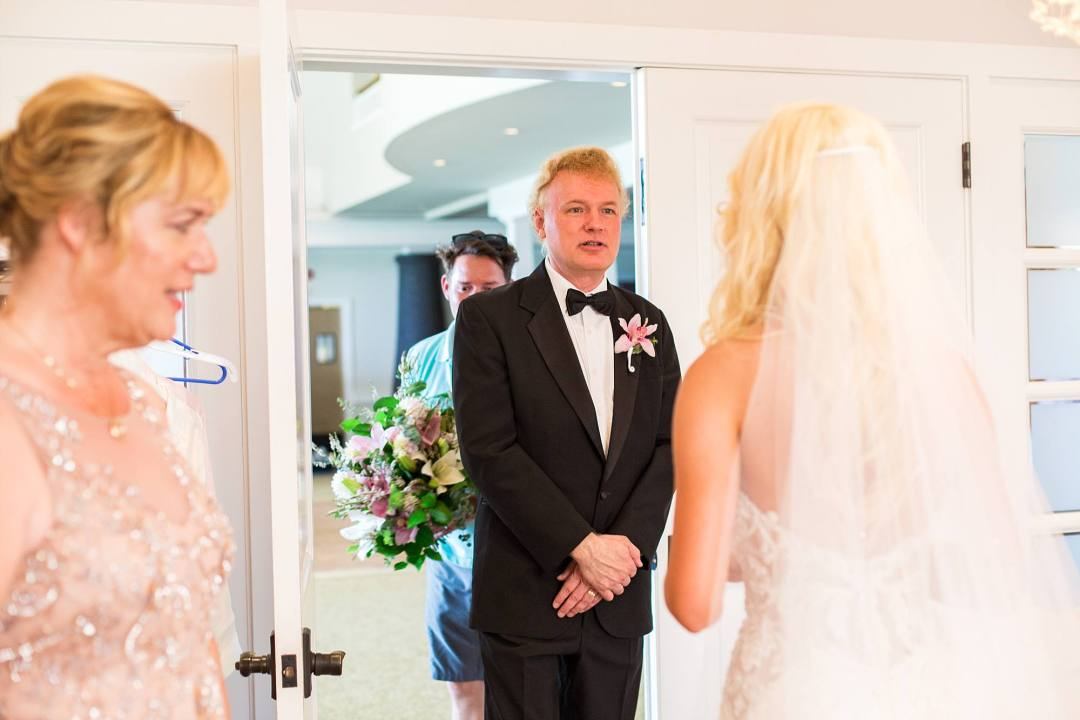 father of bride seeing her in her dress for the first time
