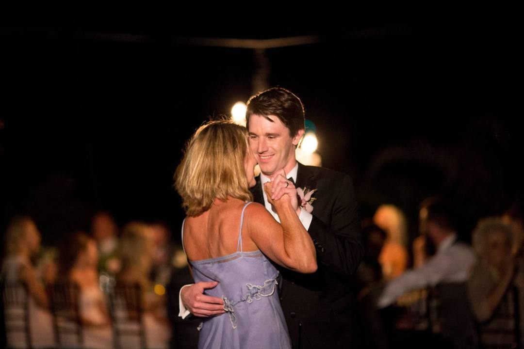 groom and his mother dancing at his wedding reception
