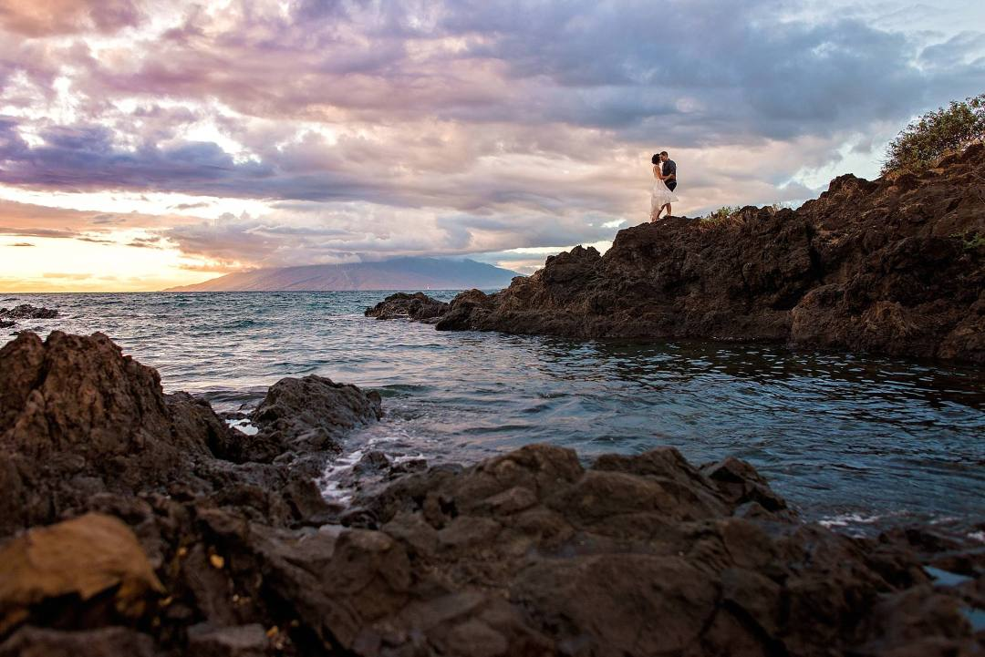 sunset in wailea, maui with an engaged couple