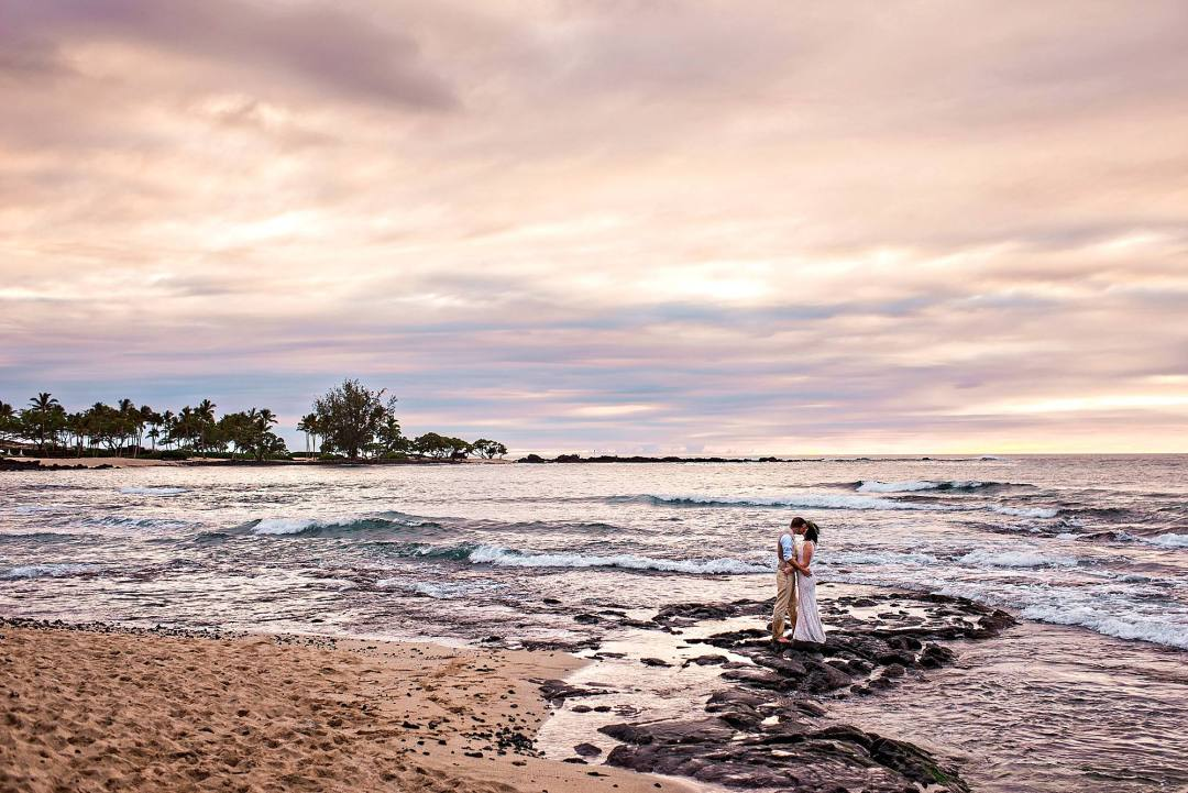 Couple kissing on lava rocks on big island