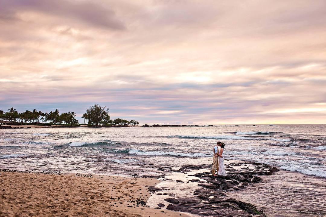Couple kissing on lava rocks on big island