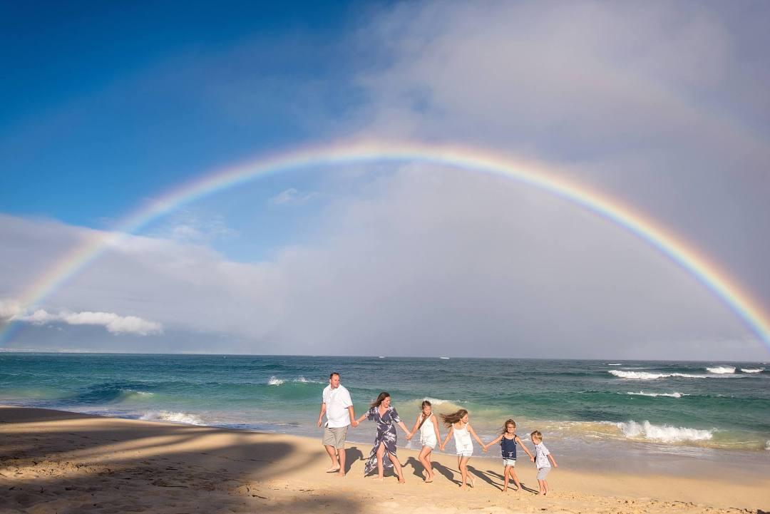family portrait under a rainbow