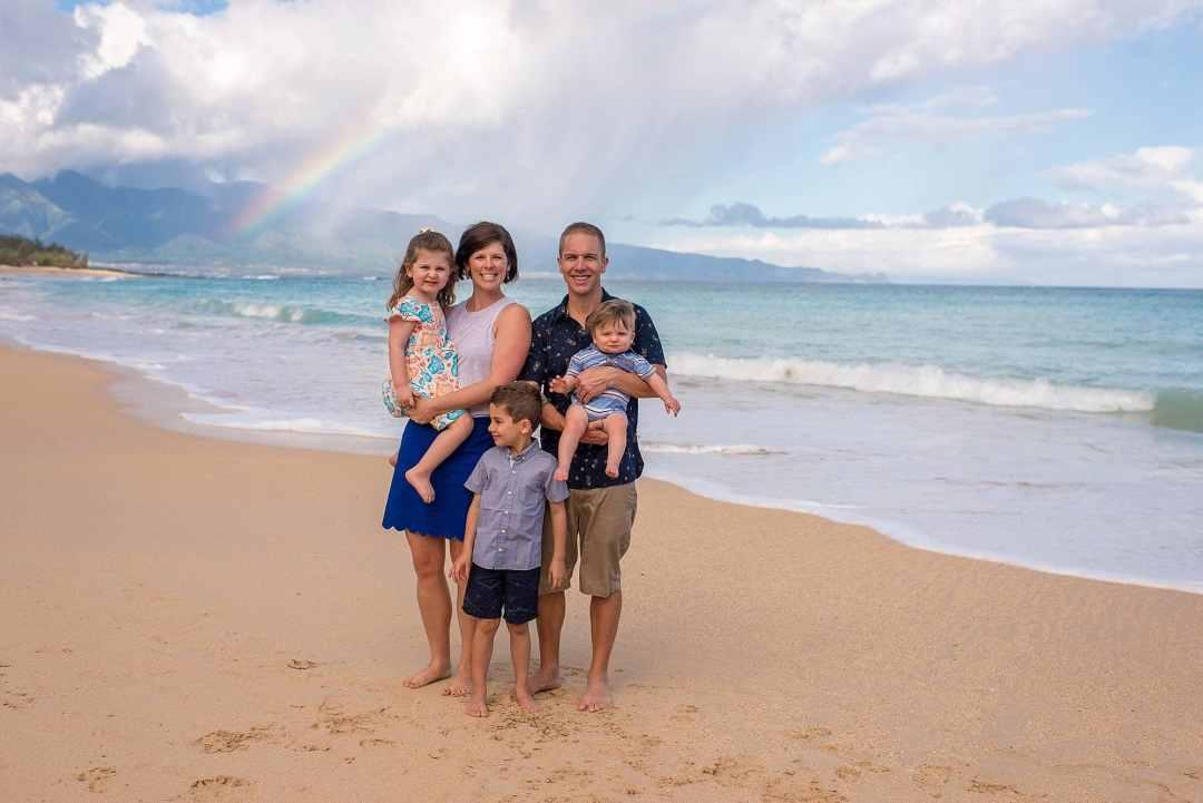 family on beach with rainbow