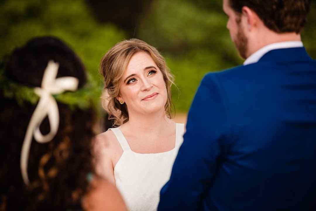 maui beach bride looking at groom