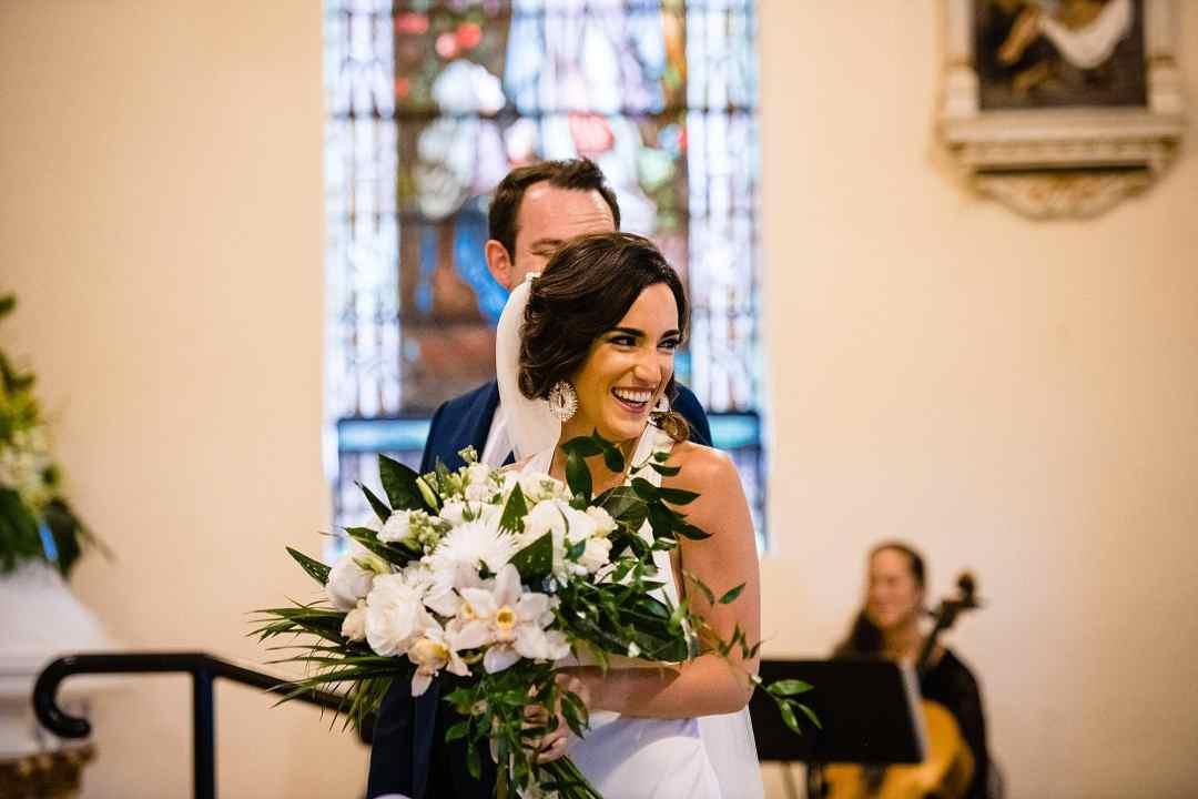 bride laughing at church wedding