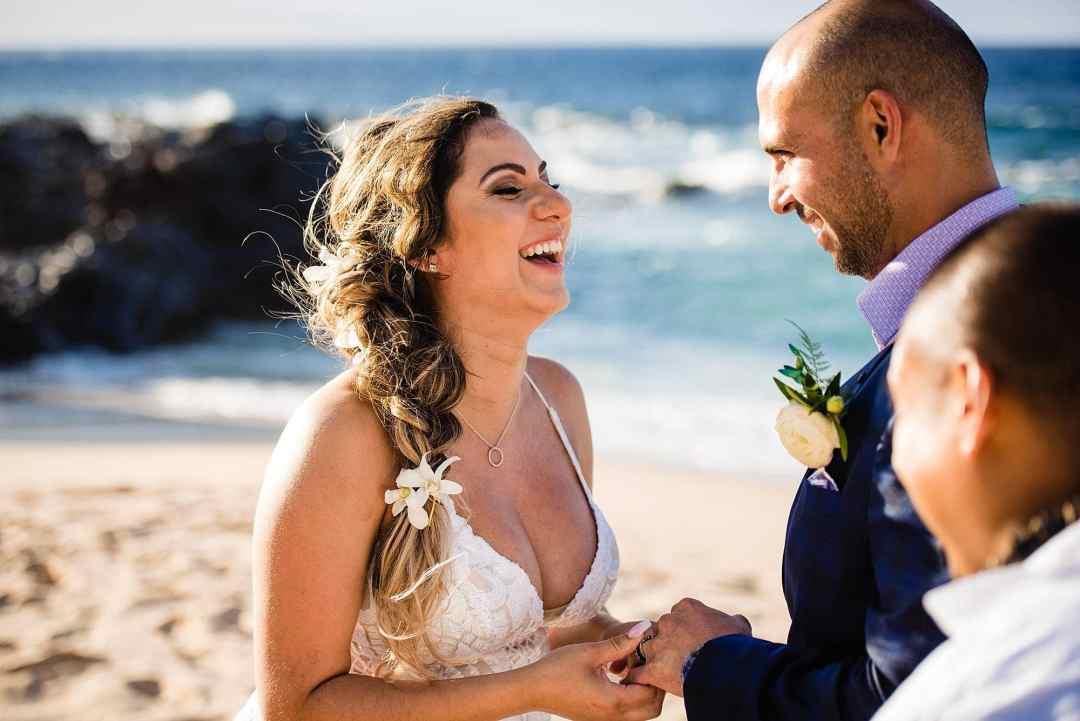bride laughing during ring exchange