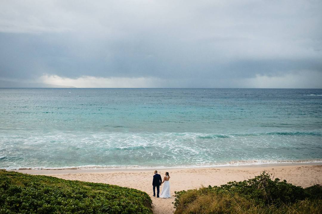 oneloa beach wedding with bride and groom