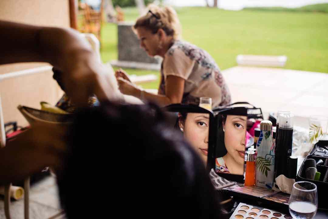 bridesmaid getting makeup done