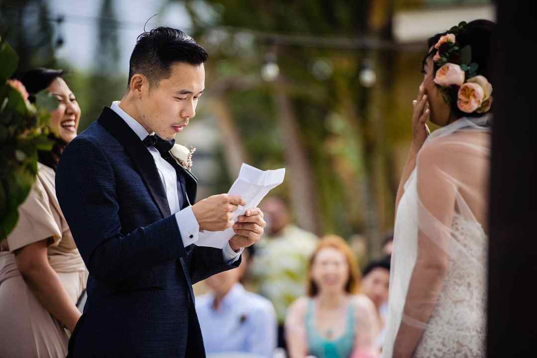 groom reading vows during wedding ceremony