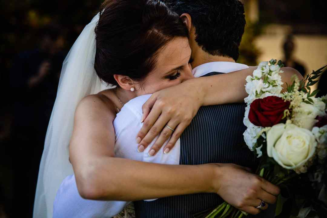 bride and groom hugging after ceremony