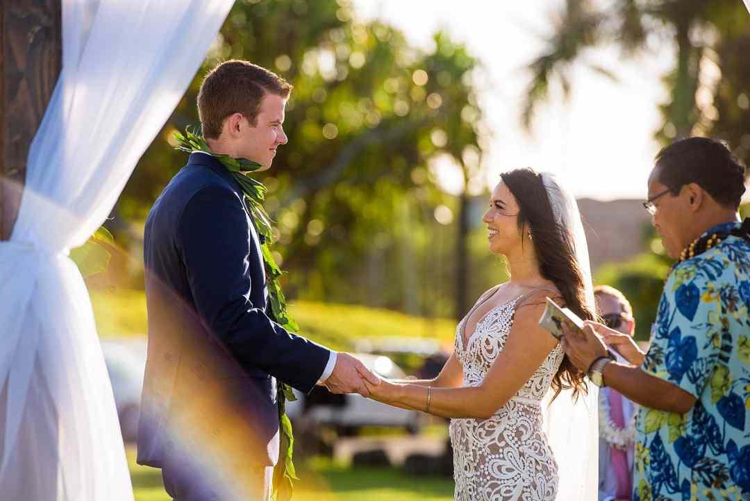 bride and groom exchanging vows at ritz carlton kapalua