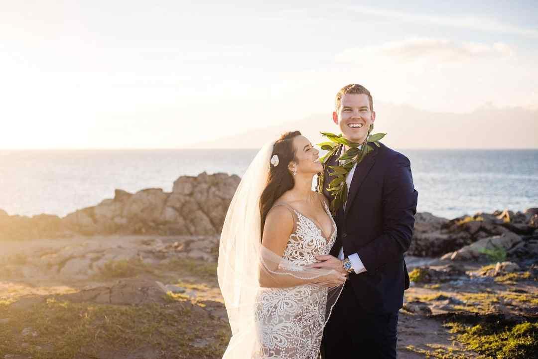 bride and groom laughing at wedding at ritz carlton kapalua