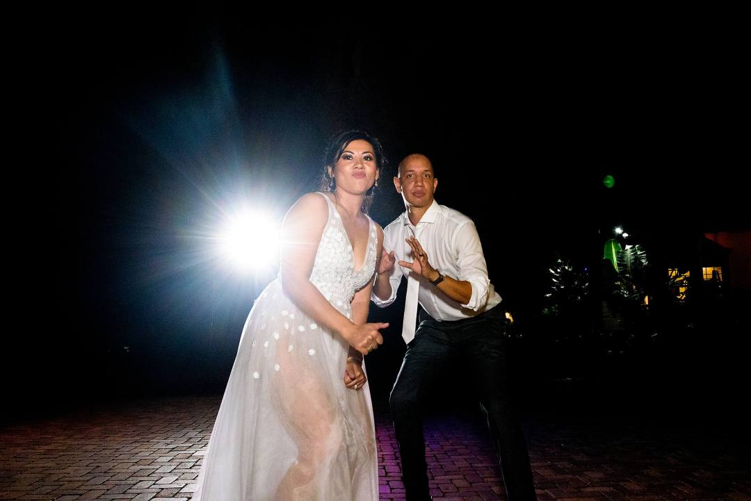 bride and groom dance at reception in hawaii