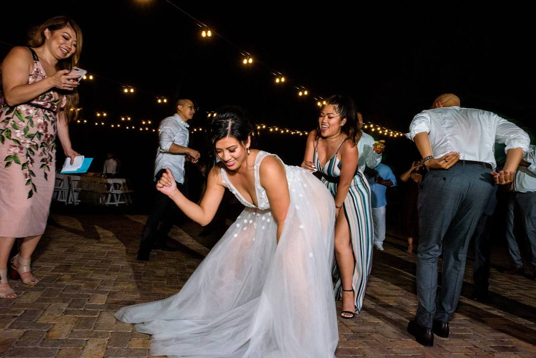 bride dancing with friends at her wedding