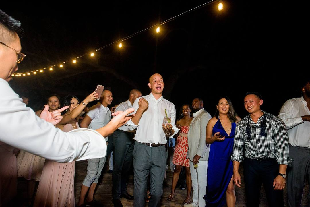 groom dancing at reception at olowalu plantation house