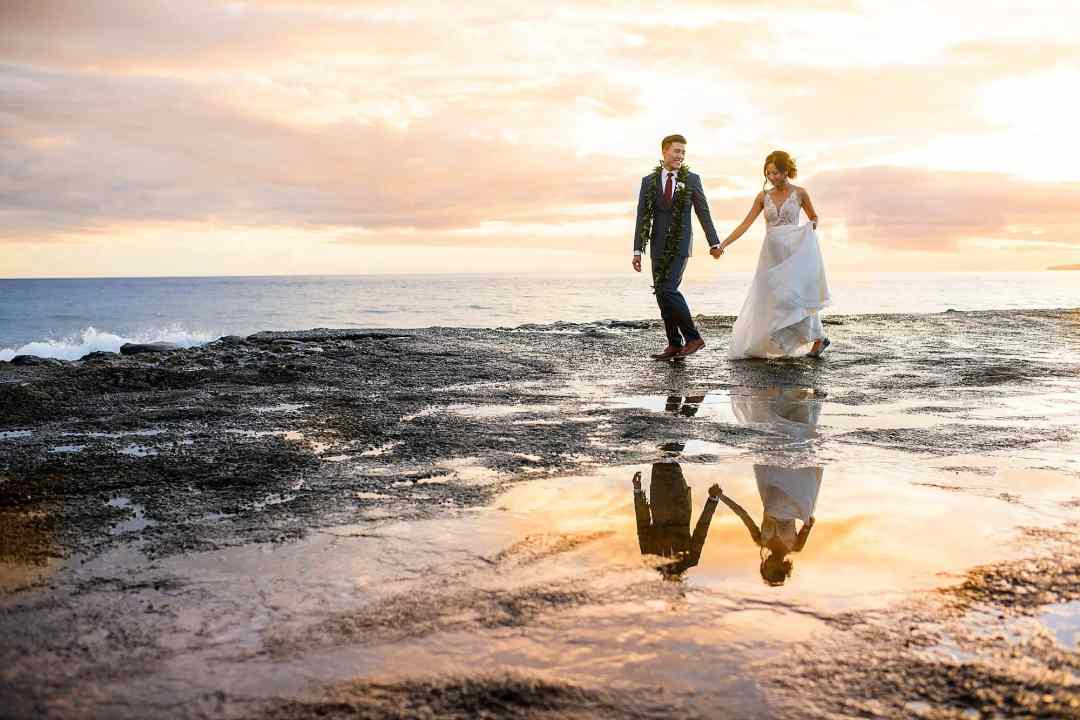 bride and groom at sunset at Olowalu Plantation House pier