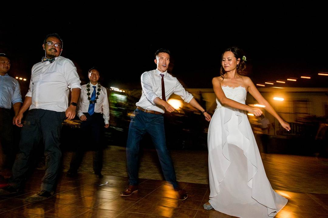 bride and groom flossing at Olowalu Plantation House