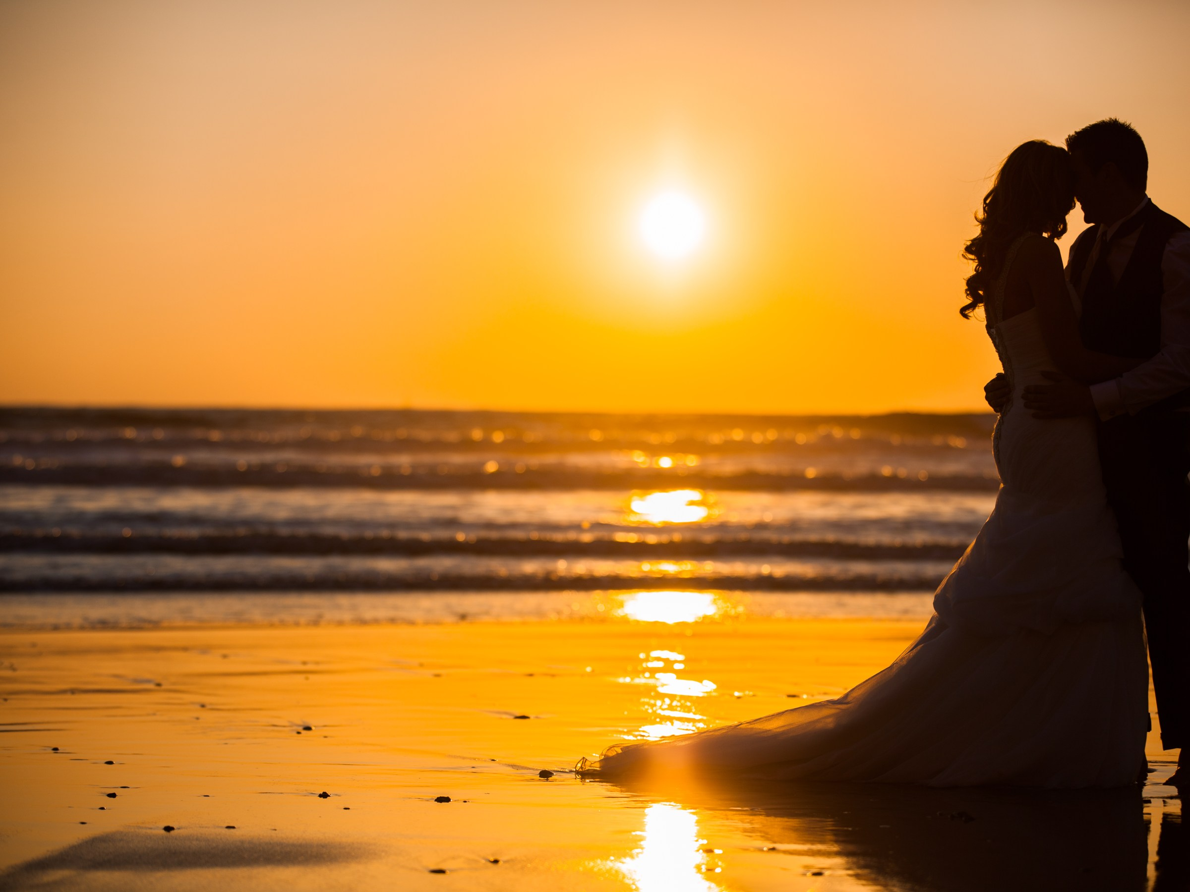 Wedding couple on beach at sunset