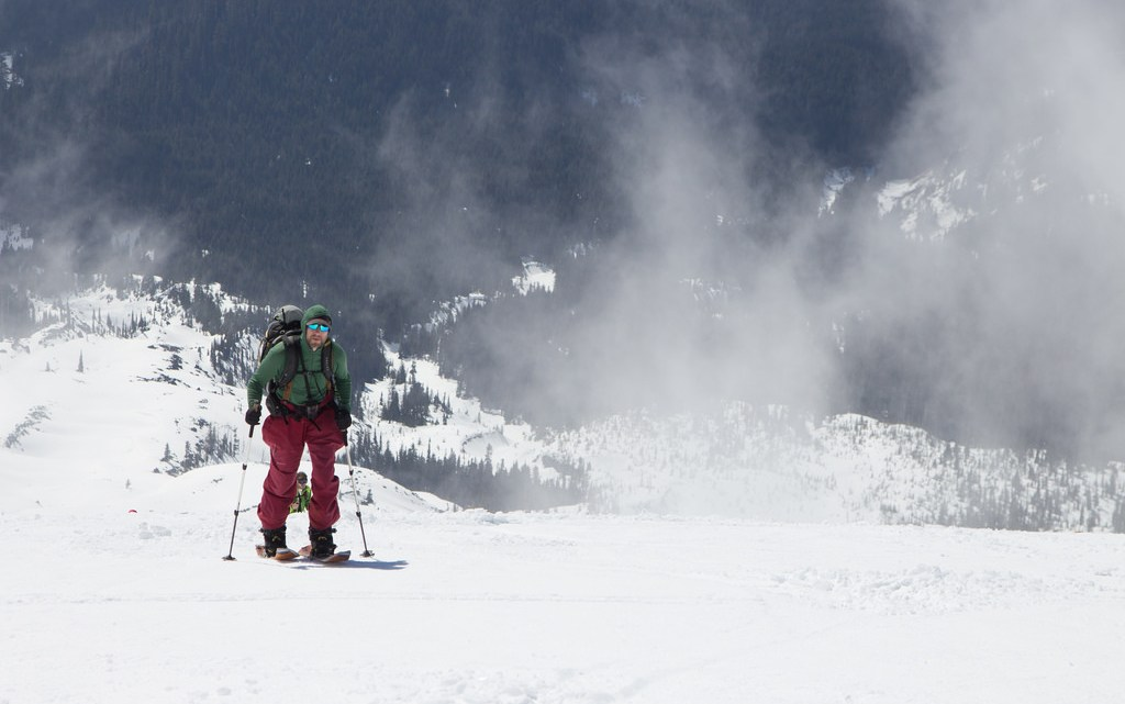 Angela Travels - April Newsletter image of friend skinning up Mount St Helens