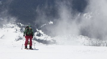 Angela Travels - April Newsletter image of friend skinning up Mount St Helens