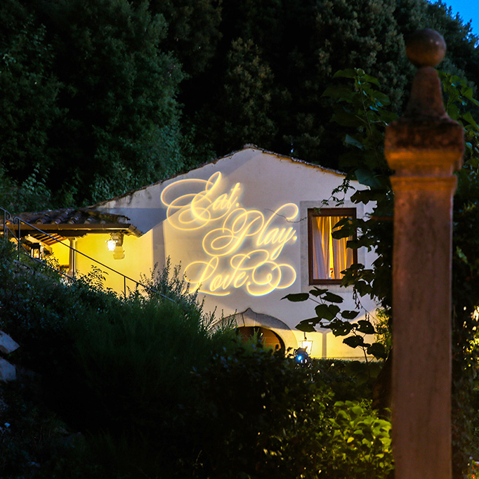 light gobo words projected on side of private hillside villa in Florence Italy