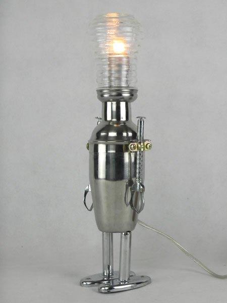 Soushake. Robot shaker lumineux avec saupoudreur, 2 pinces à glaçons et support de sèche serviettes.