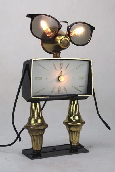 Sculpture lumineuse vintage noir et or.