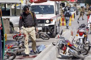 1364594816-ten-killed-in-suicide-bombing-in-peshawar_1918601