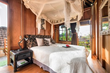 Lumbung room with QUEEN bed, draped netting, wooden lined and traditional BEDEG woven ceiling. AC + Fan cooling