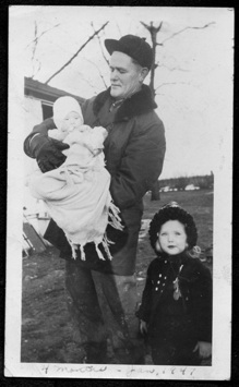 Lester Peterson with baby John and Sister