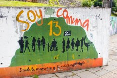 """A mural painted near the San Javier Library reads: """"I am Comuna 13, where memory and life are present."""""""