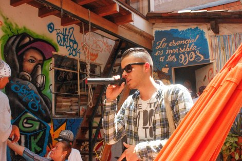 """A young rapper freestyles in the open air patio of """"La Casa Morada,"""" an activist meeting place in Medellín's Comuna 13 neighborhood."""