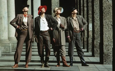4 Masculine models enjoying the sunshine in Armani,1982.