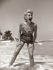 1950s Laughing Woman In Strapless Low Cut Bathing Suit Swim Wear Wading Up To Ankles In Surf da/from www.corbis.com