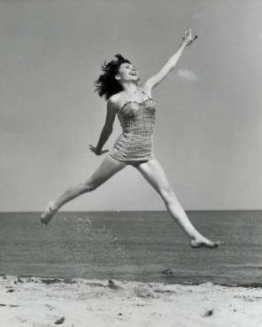 Young woman leaping on beach da/from www.corbis.com