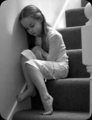 Sad girl on staircase