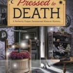 Review: Pressed to Death (Perfectly Proper Paranormal Museum #2) by Kirsten Weiss