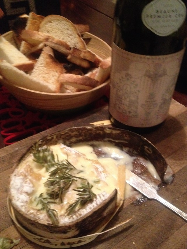 Baked french cheese and French wine from a friend of ours making wine in Burgundy - a festive treat