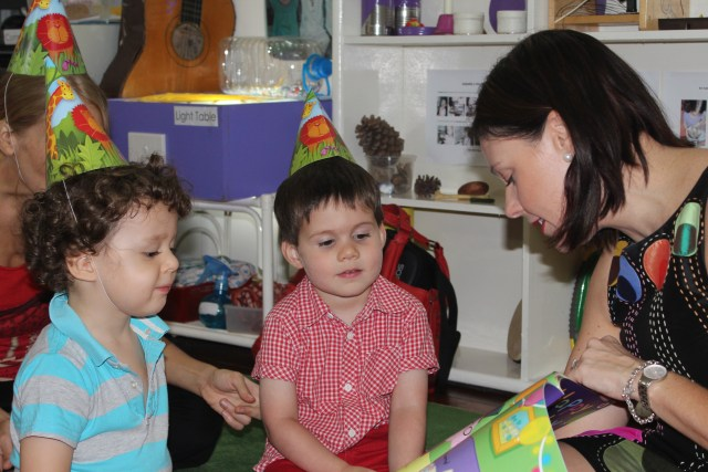 Reading to Xavier's class in Hanoi on his 3rd birthday - before going to work, September 2013