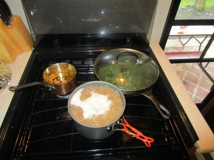 3 pots cooking lentil sausage pasta