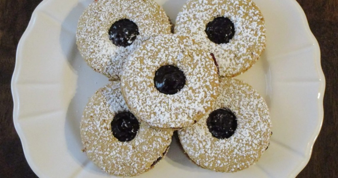 5 linzer cookies on a dish