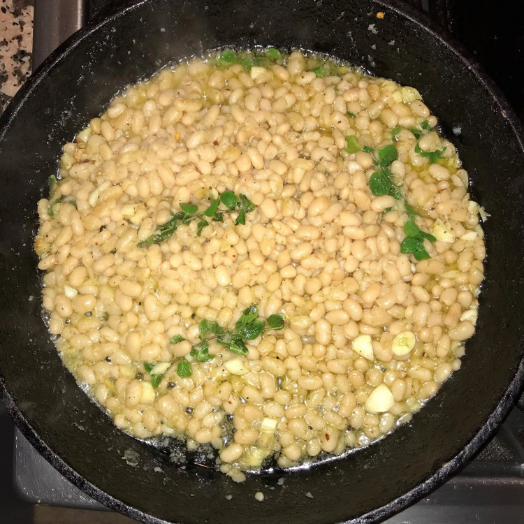 finished white beans in pan