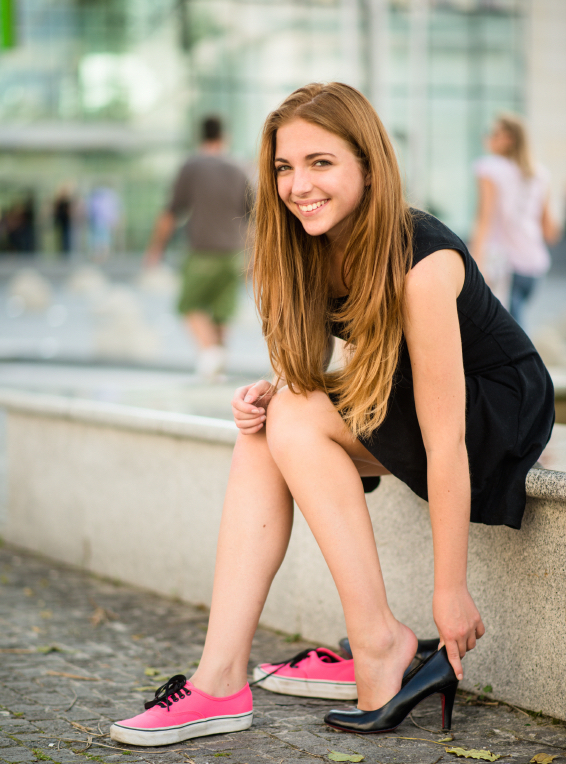 Teenager changing shoes