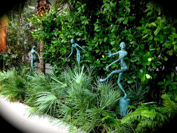 Art installations peek from the greenery throughout the resort