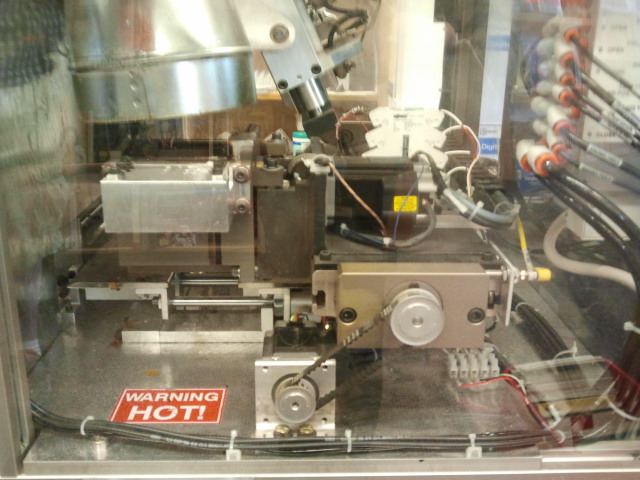 The inner workings of Homer, the Espresso Book Machine at UW-Seattle Bookstore, encased in a clear box